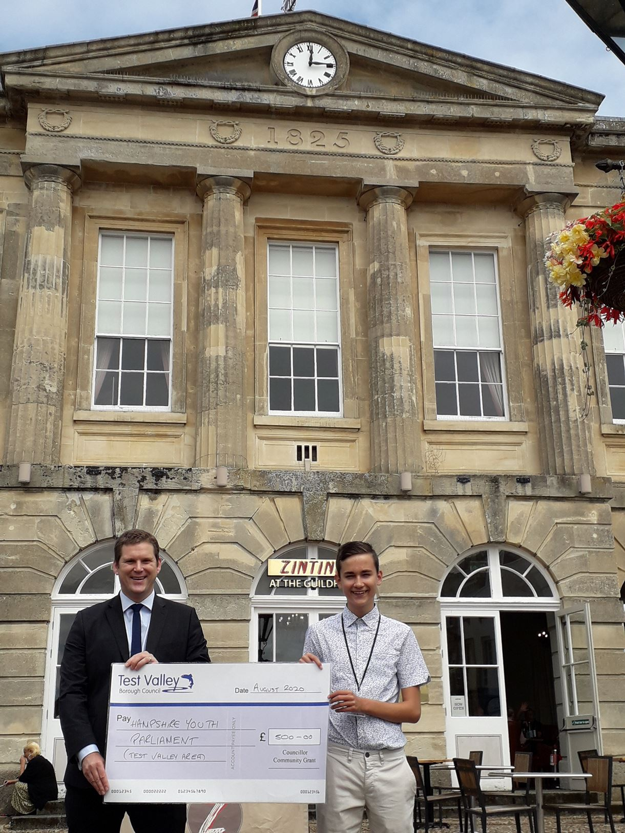 Picture caption: Councillor North presents the cheque to MYP Dmitrijs Meiksans in front of the Guildhall, Andover.